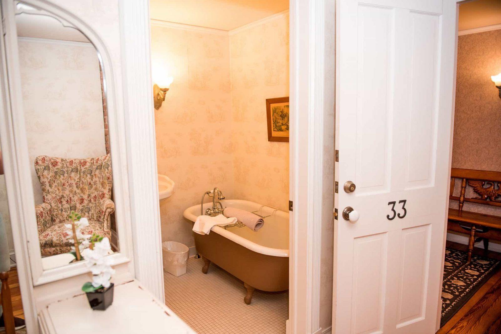Room 33 bathroom interior facing the clawfoot tub